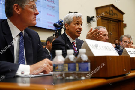 JPMorgan Chase chairman and CEO Jamie Dimon, center, testifies before the House Financial Services Committee during a hearing, on Capitol Hill in Washington