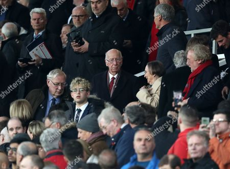 Stock Photo of Unhappy looking Sir Bobby Charlton in Stand