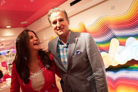Rachel Shechtman, left, founder of Story, and Macy's CEO Jeff Gennette embrace after giving a presentation on Story's opening day at Macy's, in New York. Gennette said that he's hoping that the new Story concept will get its existing customers to shop more frequently, while also attracting younger customers