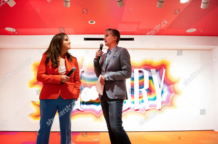 Rachel Shechtman, left, founder of Story, and Macy's CEO Jeff Gennette give a presentation on Story's opening day at Macy's, in New York. A year after buying startup Story, Macy's is bringing to life the retail concept shop to 36 stores in 15 states