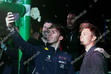 Stock Photo of Pierre Gasly, Luis Figo, Clarence Seedorf, Xabi Alonso, Nico Rosberg. Red Bull driver Pierre Gasly of France, foreground, takes a selfie with former soccer star Luis Figo, left, Clarence Seedorf, former soccer player from the Netherlands, center, Xabi Alonso, former Spanish soccer player, second from right, and Former F1 world champion Nico Rosberg of Germany after playing a cuju ball, an ancient Chinese ball game similar to soccer at the Heineken event celebrates the UEFA Champions League Trophy Tour and the 1000th Formula One Grand Prix ahead of the Chinese Formula One Grand Prix, at the Shanghai Bund in Shanghai, China