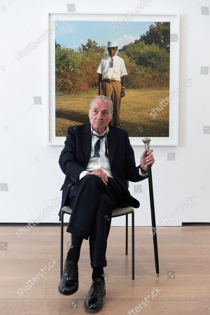 Stock Image of William Eggleston poses next to an untitled photograph as part of his exhibition titled 2¼