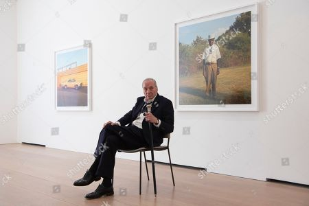 Stock Photo of William Eggleston poses next to an untitled photograph as part of his exhibition titled 2¼