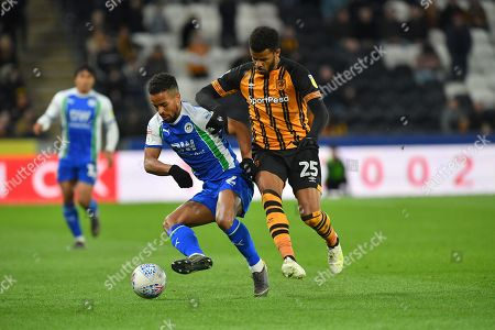 Wigan Athletic defender Nathan Byrne (2)  and Hull City forward Fraizer Campbell (25) during the EFL Sky Bet Championship match between Hull City and Wigan Athletic at the KCOM Stadium, Kingston upon Hull