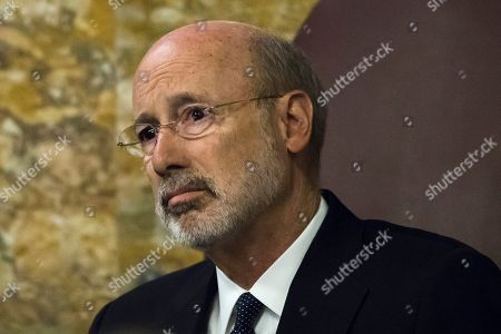 Gov. Tom Wolf listens as Pennsylvania lawmakers come together in an unusual joint session to commemorate the victims of the Pittsburgh synagogue attack that killed 11 people last year, at the state Capitol in Harrisburg, Pa