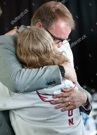 Stock Picture of Debbie Hixon, Ryan Petty. Parkland parent and commissioner on the the Marjory Stoneman Douglas High School Public Safety Commission, Ryan Petty, rear, and Debbie Hixon, who lost her husband Chris Hixon, the athletic director at Stoneman Douglas, embrace during a break in a commission meeting, in Sunrise, Fla