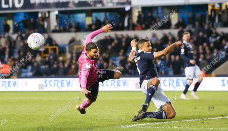 Nahki Wells of QPR  flies out of a tackle by James Meredith of Millwall