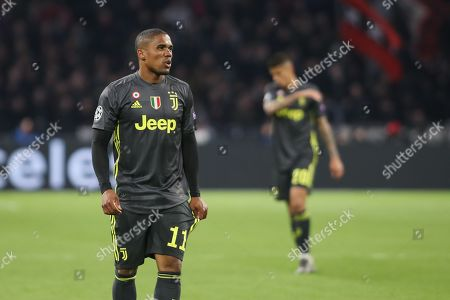 Douglas Costa and Paulo Dybala of Juventus during the Champions League Quarter-Final Leg 1 of 2 match between Ajax and Juventus FC at the Amsterdam Arena, Amsterdam