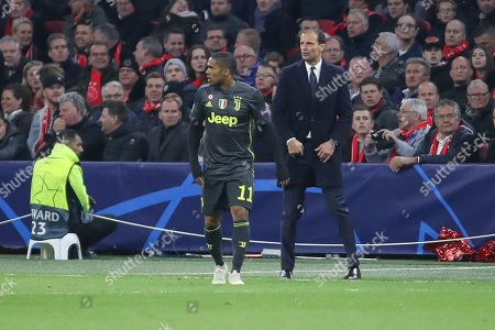 Douglas Costa and Massimiliano Allegri of Juventus during the Champions League Quarter-Final Leg 1 of 2 match between Ajax and Juventus FC at the Amsterdam Arena, Amsterdam