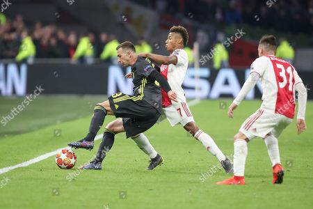 Federico Bernardeschi of Juventus against David Neres of Ajax during the Champions League Quarter-Final Leg 1 of 2 match between Ajax and Juventus FC at the Amsterdam Arena, Amsterdam