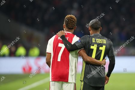 Douglas Costa of Juventus and David Neres of Ajax during the Champions League Quarter-Final Leg 1 of 2 match between Ajax and Juventus FC at the Amsterdam Arena, Amsterdam