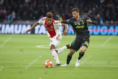 David Neres of Ajax against Rodrigo Bentancur of Juventus during the Champions League Quarter-Final Leg 1 of 2 match between Ajax and Juventus FC at the Amsterdam Arena, Amsterdam