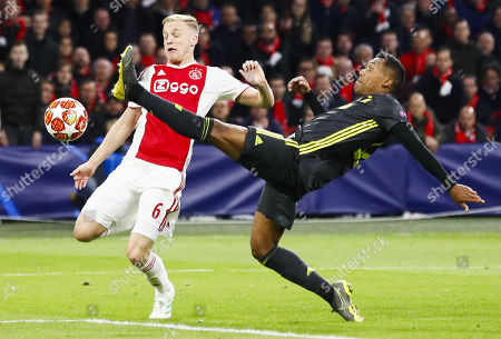 Donny van de Beek (L) of Ajax in action against Douglas Costa of Juventus during the UEFA Champions League quarter final first leg soccer match betweeen Ajax Amsterdam and Juventus FC in Amsterdam, The Netherlands, 10 April 2019.