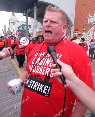 Bob McDevitt, left, president of Local 54 of the Unite Here casino workers union, speaks to reporters outside the Trump Taj Mahal casino in Atlantic City N.J. hours after the union went on strike against the casino, which was owned by billionaire investor Carl Icahn. On April 10, 2019, McDevitt's union called on casino regulators in New Jersey, Nevada and Ohio to protect casino workers from hedge fund or private equity firms that own casinos if they seek to quickly extract profits from the properties while hurting workers