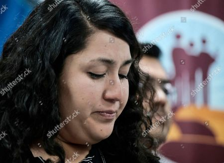 Melissa Castro weeps as she talks about her husband, Jose Luis Ibarra Bucio, during a news conference at the offices of the Coalition for Humane Immigrant Rights of Los Angeles (CHIRLA), in Los Angeles. The family of the 27-year-old man who died after a short stint in a California immigration detention facility demanded answers Wednesday about what happened to him and the timing of his release. Melissa Castro said her husband, was released as his health deteriorated from a brain hemorrhage and while he was in a coma from which he never awoke