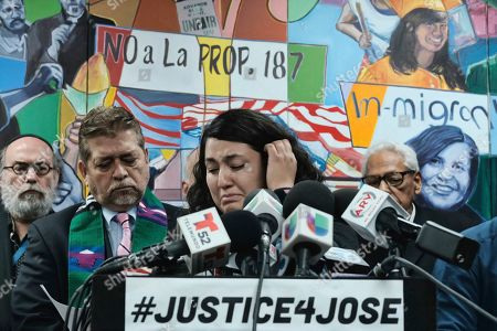 Melissa Castro tries to force back tears as she talks about her husband, Jose Luis Ibarra Bucio, while joined by local religious leaders during a news conference at the offices of the Coalition for Humane Immigrant Rights of Los Angeles (CHIRLA), in Los Angeles. The family of the 27-year-old man who died after a short stint in a California immigration detention facility demanded answers Wednesday about what happened to him and the timing of his release. Melissa Castro said her husband, was released as his health deteriorated from a brain hemorrhage and while he was in a coma from which he never awoke