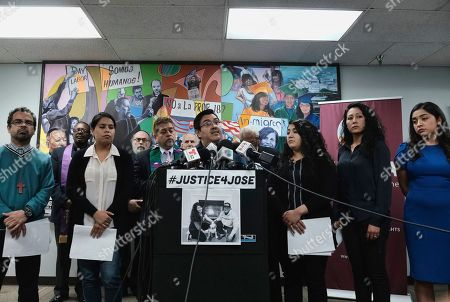 Jorge-Mario Cabrera center, Director of Communications for the Coalition for Humane Immigrant Rights of Los Angeles (CHIRLA), speaks during a news conference, in Los Angeles. The family of a 27-year-old man who died after a short stint in a California immigration detention facility demanded answers Wednesday about what happened to him and the timing of his release. Melissa Castro said her husband, Jose Luis Ibarra Bucio, was released as his health deteriorated from a brain hemorrhage and while he was in a coma from which he never awoke