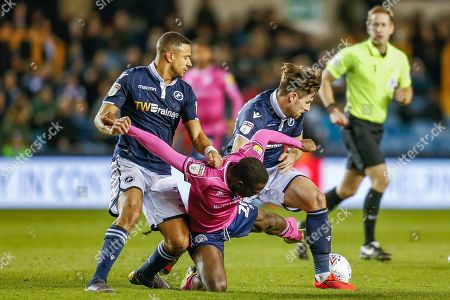 Queens Park Rangers midfielder Bright Osayi-Samuel (20) struggles to keep possession as he is challenged by Millwall defender Ryan Leonard (28) and Millwall defender James Meredith (3)  during the EFL Sky Bet Championship match between Millwall and Queens Park Rangers at The Den, London