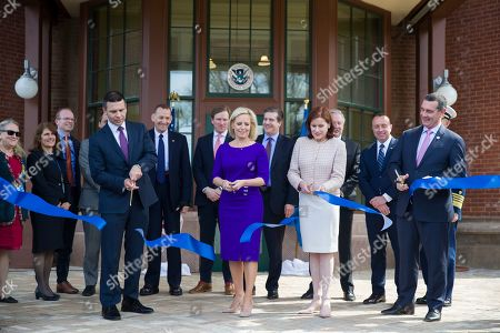 Kirstjen Nielsen, Claire Grady, David Pekoske, Kevin McAleenan. Outgoing Homeland Security Secretary Kirstjen Nielsen, front center left, cuts a ribbon accompanied by outgoing acting deputy secretary Claire Grady, front center right, Incoming Acting Homeland Security Secretary Kevin McAleenan, front left, and Administrator of the Transportation Security Administration David Pekoske, front right at the dedication ceremony at the Homeland Security headquarters Center Building at the old St. Elizabeths Hospital, in Washington
