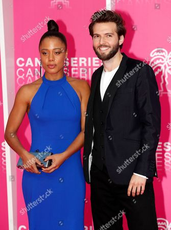 Cast members of 'The Feed', British actors Nina Toussaint-White (L) and Guy Burnet (R) pose on the pink carpet before the closing ceremony of the Cannes Series Festival in Cannes, France, 10 April 2019.