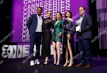 Ramzy Bedia (L), Spanish actresses Aixa Villagran (2-L), Leticia Dolera (C) and Celia Freijeiro (2-R) pose after they won the Best Series award for the TV series 'Perfect Life' at the Cannes Series Festival in Cannes, 10 April 2019.