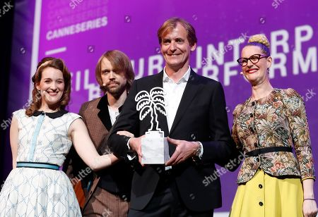 Lars Kraume (2-R) poses with the Best Music award for the TV series 'Nehama' at the Cannes Series Festival in Cannes, France, 10 April 2019.
