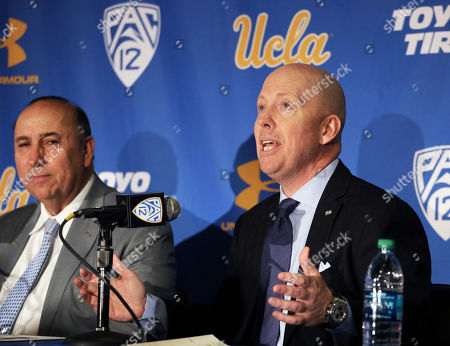 As athletic director Dan Guerrero listens, right, Mick Cronin speaks after he is introduced as the UCLA's new head basketball coach at a news conference on the campus in Los Angeles . Cronin was hired as UCLA's basketball coach Tuesday, ending a bumpy, months-long search to find a replacement for the fired Steve Alford. The university said Cronin agreed to a $24 million, six-year deal