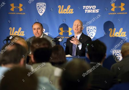 Mick Cronin, right, with athletic director Dan Guerrero, is introduced as the UCLA's new head basketball coach at a news conference on the campus in Los Angeles . Cronin was hired as UCLA's basketball coach Tuesday, ending a bumpy, months-long search to find a replacement for the fired Steve Alford. The university said Cronin agreed to a $24 million, six-year deal