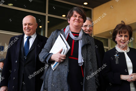 Northern Ireland Democratic Unionist Party leader Arlene Foster, center, speaks to journalists after her meeting with European Union chief Brexit negotiator Michel Barnier at EU headquarters in Brussels, . At left is British conservative politician Iain Duncan Smith and second right is Owen Paterson