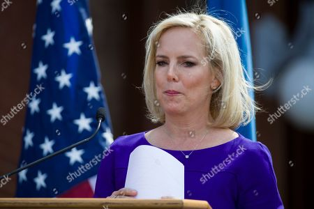 Stock Picture of Outgoing Homeland Security Secretary Kirstjen Nielsen gathers her papers after speaking at the dedication ceremony at the Homeland Security headquarters Center Building at the old St. Elizabeths Hospital, in Washington