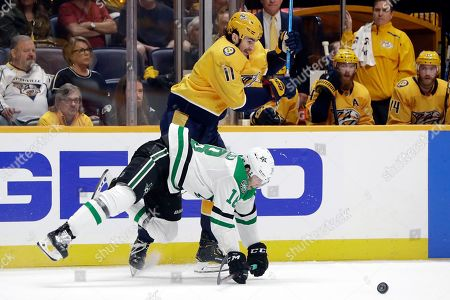 Tyler Pitlick, Brian Boyle. Dallas Stars center Tyler Pitlick (18), of Sweden, falls as he vies for the puck with Nashville Predators center Brian Boyle (11) during the third period in Game 1 of an NHL hockey first-round playoff series, in Nashville, Tenn. The Stars won 3-2