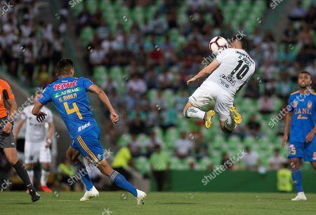 Santos Laguna's Carlos Valdez (R) vies for the ball against Tigres' Hugo Ayala (L) during a Liga de Campeones of CONCACAF match held at the Corona stadium in Torreon, Mexico, 10 April 2019.