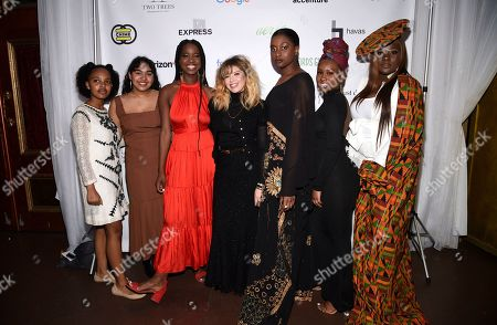 Natasha Lyonne, center, poses with Lower Eastside Girls Club girls at the Lower Eastside Girls Club Spring Fling gala at the Angel Orensanz Foundation, in New York
