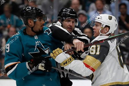 Evander Kane, Jonathan Marchessault. Linesman Steve Miller, center, separates San Jose Sharks' Evander Kane, left, from Vegas Golden Knights' Jonathan Marchessault during the second period of Game 1 of an NHL hockey first-round playoff series, in San Jose, Calif