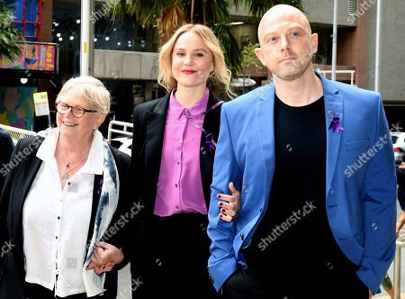 Australian actress Eryn-Jean Norvill (C) arrives with family to the Supreme Court in Sydney, Australia, 11 April 2019. Australian actor Geoffrey Rush won the defamation case against Australian publisher Nationwide News Limited that accused him of sexual misconduct against Australian actress Eryn-Jean Norvill.
