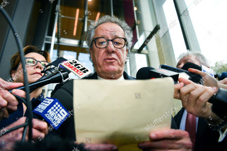 Australian actor Geoffrey Rush (C) speaks to the media alongside his wife Jane Menelaus (L) outside the Supreme Court in Sydney, Australia, 11 April 2019. Australian actor Geoffrey Rush won the defamation case against an Australian news paper a that accused him of sexual misconduct against Australian actress Eryn-Jean Norvill.