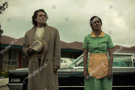 Stock Image of Ian McShane as Mr. Wednesday and Sakina Jaffrey as Mama-Ji
