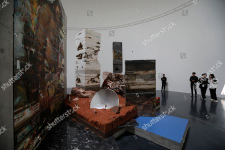 Stock Picture of People visit the artwork  'Sometimes you wonder, in an interconnected universe, who is dreaming who' by artist Adrian Villar Rojas at Tank Shanghai art space project in Shanghai, China, 11 April 2019. The Tank Shanghai which is an art space founded by renowned contemporary art collector Qiao Zhibing. It's a multifunctional cultural hub that combines exhibition venue with parkland, plaza, bookstore, education center and restaurant. This art space project spans over 60,000 square meters including five disused oil tanks that formerly stored fuel for the nearby Hongqiao International airport located on the banks of Shanghai's Huangpu river.