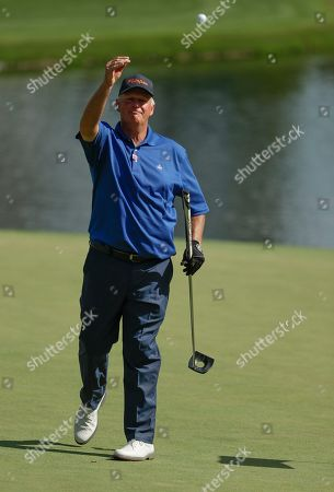 Sandy Lyle, of Scotland, throws his ball to the crowd after making a birdie ton the 16th hole during the first round for the Masters golf tournament, in Augusta, Ga