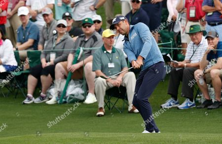 Stock Photo of Charl Schwartzel of South Africa chips on the second hole during the first round of the 2019 Masters Tournament at the Augusta National Golf Club in Augusta, Georgia, USA, 11 April 2019. The 2019 Masters Tournament is held 11 April through 14 April 2019.