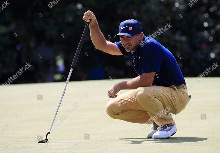 Trevor Immelman of South Africa lines up a putt on the first hole during the first round of the 2019 Masters Tournament at the Augusta National Golf Club in Augusta, Georgia, USA, 11 April 2019. The 2019 Masters Tournament is held 11 April through 14 April 2019.