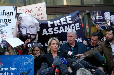 Kristinn Hrafnsson, editor of WikiLeaks, center right, and barrister Jennifer Robinson speak to the media outside Westminster magistrates court where WikiLeaks founder Julian Assange was appearing in London, . WikiLeaks founder Julian Assange was forcibly bundled out of the Ecuadorian Embassy in London and into a waiting British police van on Thursday, setting up a potential court battle over attempts to extradite him to the U.S. to face charges related to the publication of tens of thousands of secret government documents