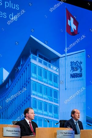 Nestle's CEO Ulf Mark Schneider (L) and Nestle's Paul Bulcke, Chairman of the Board of Directors react during the general meeting of the world's biggest food and beverage company Nestle Group in Lausanne, Switzerland, 11 April 2019.