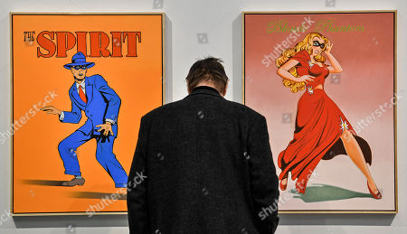 A visitor watches artwork by pop artist Mel Ramos at the ART COLOGNE fair in Cologne, Germany, . The yearly art fair for international galleries present art of the 20th and 21st centuries since 1967 in Cologne