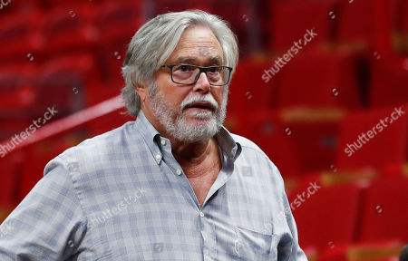 In this March 13, 2019 photo, Micky Arison, Miami Heat managing general partner and chairman of Carnival Cruise Line, walks courtside before the start of an NBA basketball game in Miami. A federal judge has threatened to temporarily block Carnival Corp. from docking cruise ships at ports in the United States as punishment for a possible probation violation. The Miami Herald reports U.S. District Judge Patricia Seitz said that she'll make a decision in June, and she wants company chairman Micky Arison and president Donald Arnold to attend that hearing