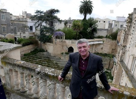 Aleksandr Sokurov poses before he recives the Golden Olive Tree (Ulivo d'Oro) trophy during a photocall as part of the European Film Festival in Lecce, Puglia region, southern Italy, 11 April 2019. The festival runs from 08 to 13 April.