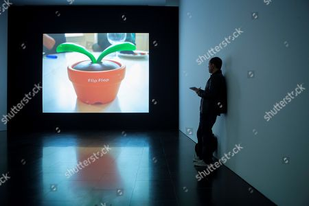 Stock Photo of A visitor looks at an artwork by Swiss-American artist Christian Marclay during the press preview of the exhibition 'Christian Marclay: Compositions' at the Museum of Contemporary Art (MACBA) in Barcelona, Spain, 11 April 2019. Marclay's first exhibition over a decade in Spain will be open for the public from 12 April to 24 September 2019.