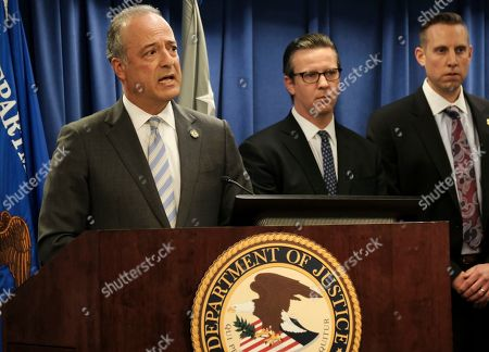 United States Attorney Nick Hanna, left announces the latest on new federal charges against attorney Michael Avenatti during a news conference in Los Angeles on . Avenatti could face a sentence of 335 years in prison if convicted of charges in a 36-count federal indictment. The indictment announced Thursday in Los Angeles alleges Avenatti stole millions of dollars from clients, didn't pay taxes, committed bank fraud and lied during bankruptcy proceedings