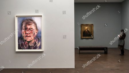 "A visitor viewing ""Self-Portrait with Two Circles"", 1665, (R) by Rembrandt van Rijn, the highlight of the exhibition.  ""Untitled"", 2019, (L) by Jenny Saville, is a new work, seen for the first time, created in response to Rembrandt's self-portrait."