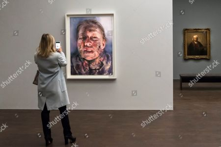 "A visitor viewing ""Untitled"", 2019, by Jenny Saville, a new work, seen for the first time, created in response to Rembrandt's self-portrait, ""Self-Portrait with Two Circles"" (R) which is the highlight of the exhibition."